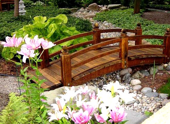 Decorative wooden bridge in the garden for Decorative fish pond bridge
